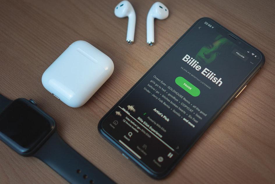 pasar toda musica apple music spotify